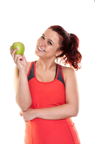 Eating apple after sport stock photo