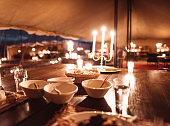 eating at candle light in a tent
