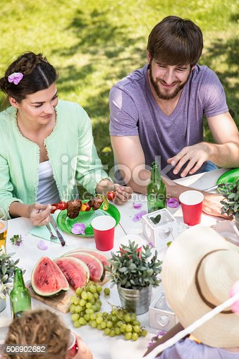 696841580istockphoto Eating at the garden party 506902682