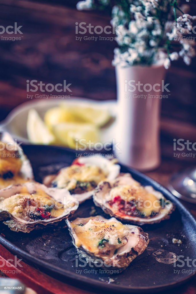 Eating Baked Oysters au Gratin royalty-free stock photo