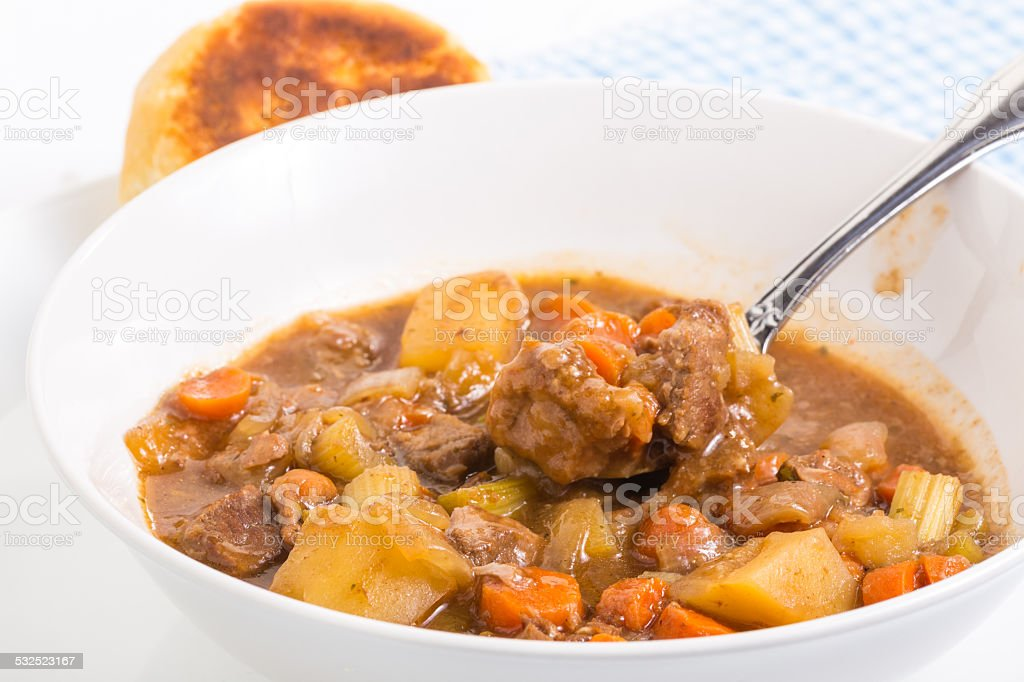 Eating Beef Stew stock photo