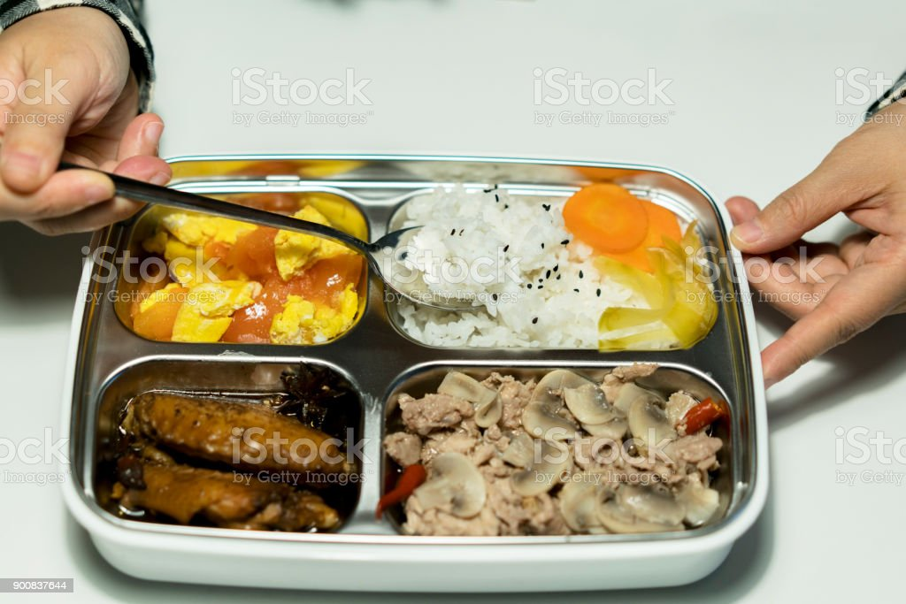 eating bento lunch stock photo