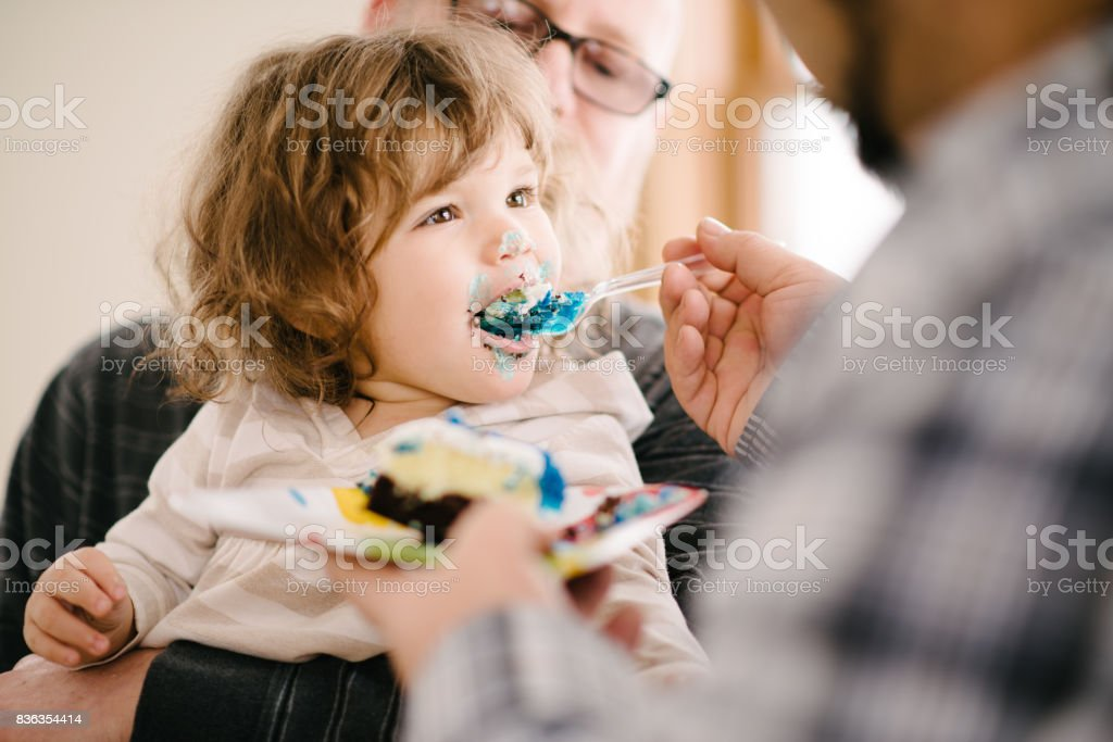 Eating birthday cake stock photo