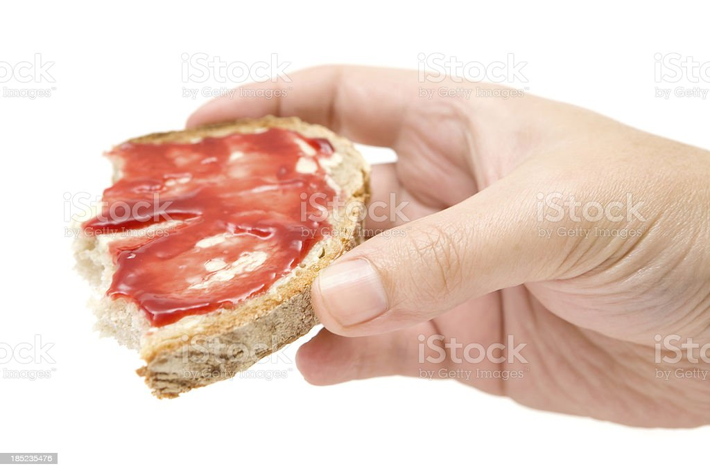 Eating Bread with Butter and Jam royalty-free stock photo