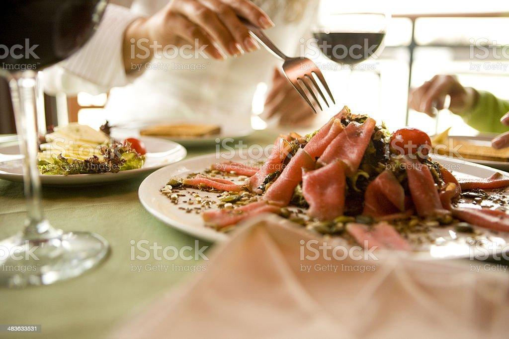 Eating carpaccio stock photo