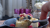 istock Eating CheeseCake with Fresh Berries and Honey 1086758676