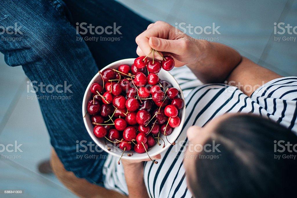 eating cherries stock photo