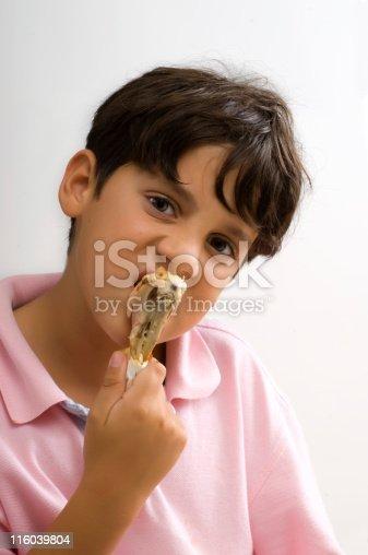 child eating a chicken leg on white background