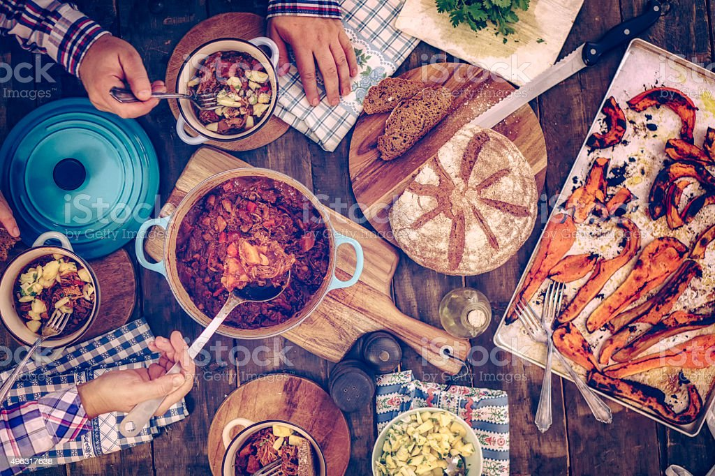 Eating Chili Goulash Stew with Pumpkins and Mushrooms stock photo