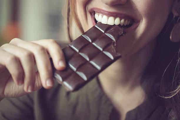 eating chocolate - pure chocola stockfoto's en -beelden