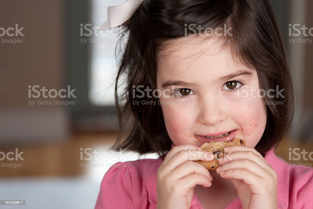 Eating cookie royalty-free stock photo