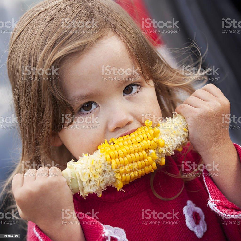 Eating corn royalty-free stock photo