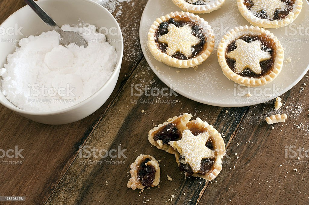 Eating delicious fresh baked Christmas mince pies stock photo