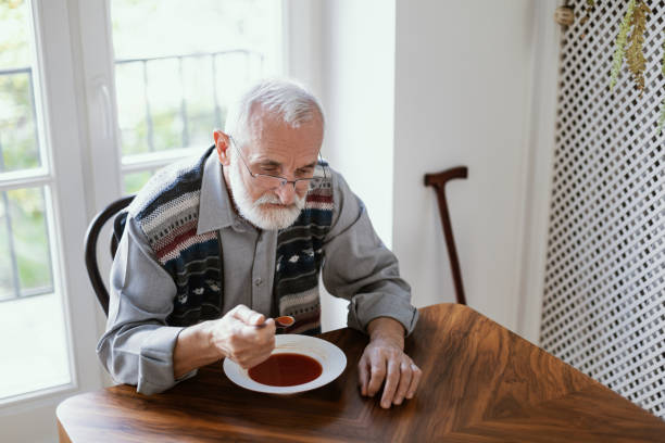 Eating dinner by himself stock photo