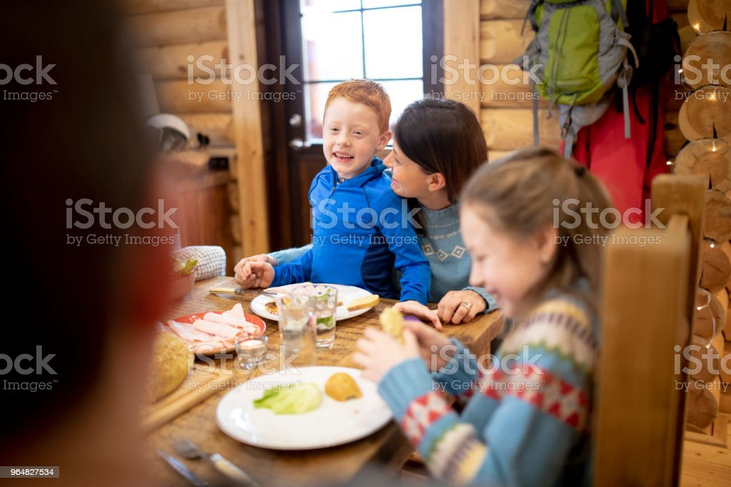 Eating Dinner with his Mother royalty-free stock photo