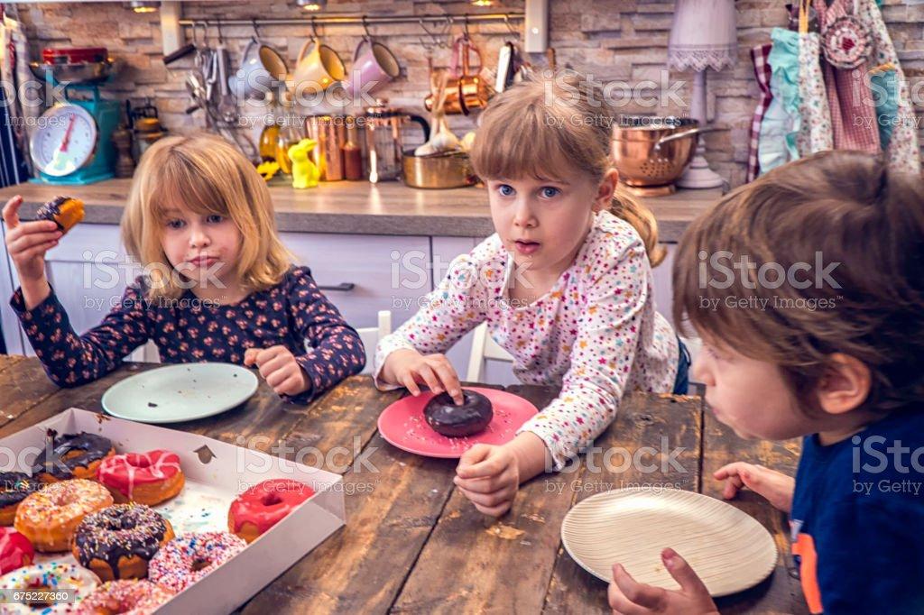 Eating Donuts Donuts at Home royalty-free stock photo