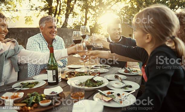 Eating, drinking and being merry with loved ones Shot of a multi-generational family having lunch together outsidehttp://195.154.178.81/DATA/i_collage/pu/shoots/804597.jpg 2015 Stock Photo