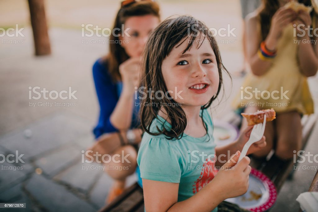 Eating Food at a Family BBQ stock photo