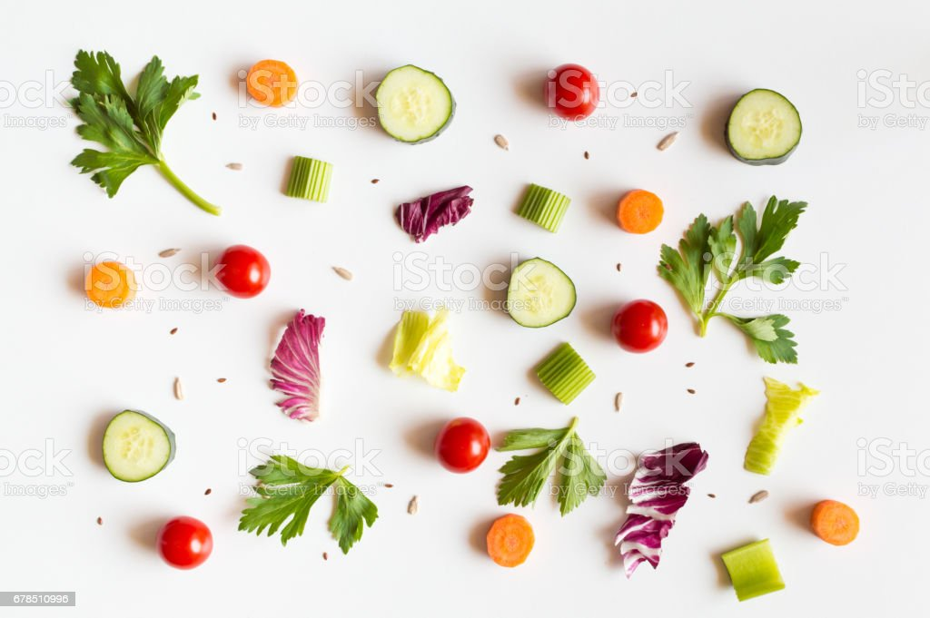 Eating food pattern with raw ingredients of salad on white background stock photo