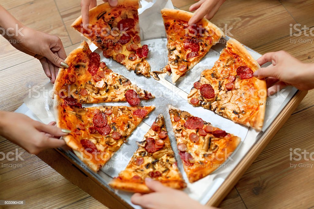 Eating Food. People Taking Pizza Slices. Friends Leisure, Fast Food stock photo