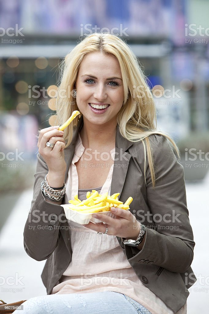 Eating fries royalty-free stock photo