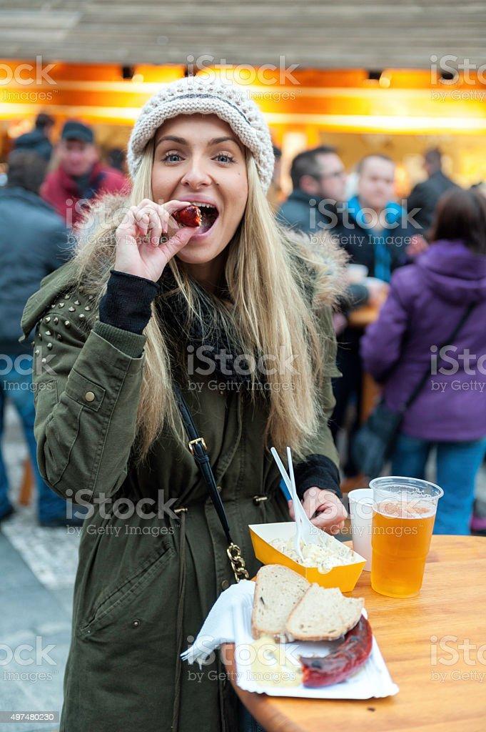 Eating german sausage stock photo