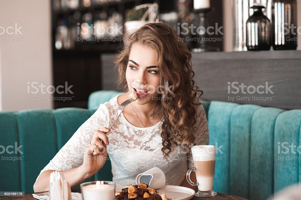 Eating girl in restaurant stock photo