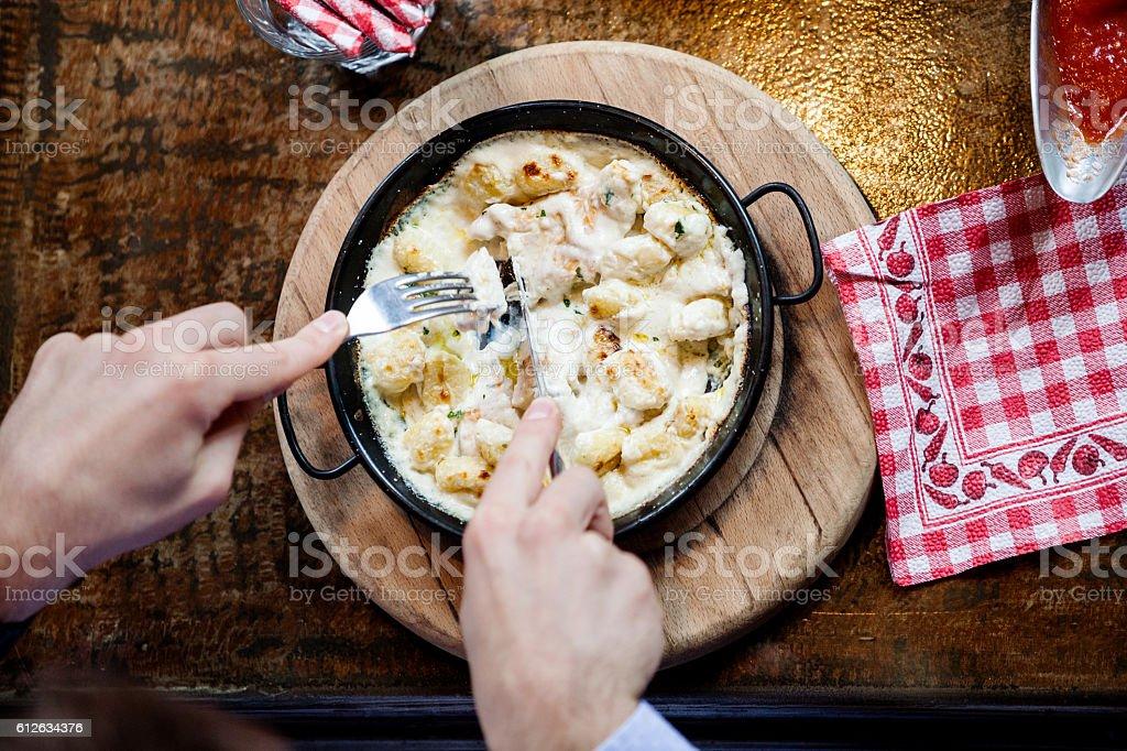 Eating gnocchi stock photo