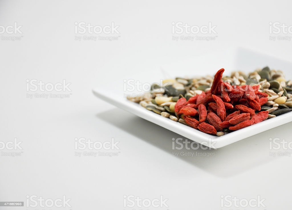 eating goji, pumpkin and sun flower seeds royalty-free stock photo