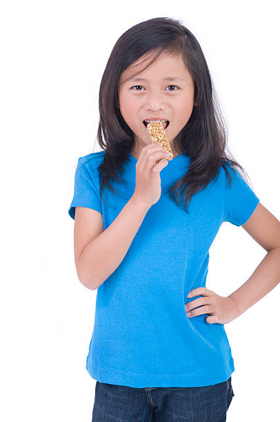 Eating Granola Bar stock photo