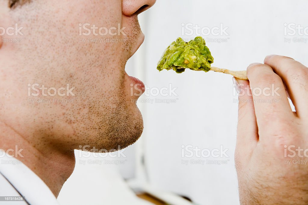 Eating Guacamole And Chips stock photo