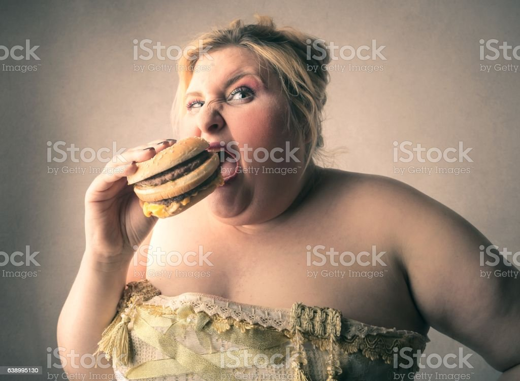 Eating hamburger stock photo