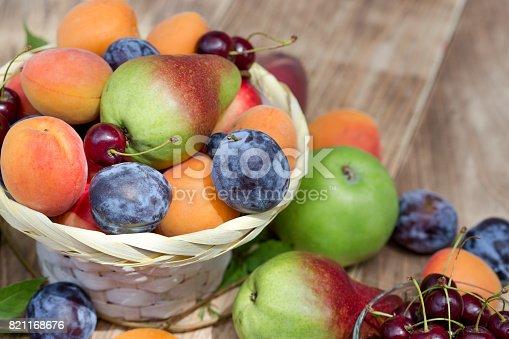 istock Eating healthy food - fresh organic fruits in wicker basket 821168676