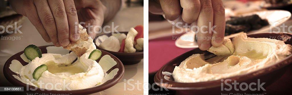 Eating Hummus with Pita Bread stock photo