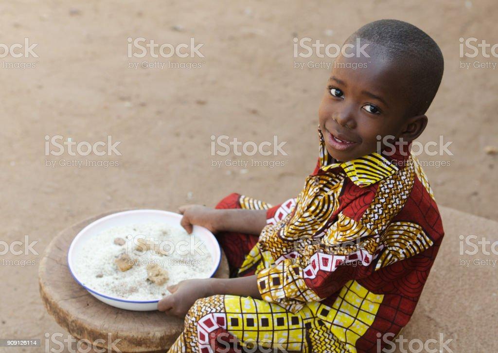 Eating in Africa - Little Black Boy Hunger Symbol stock photo