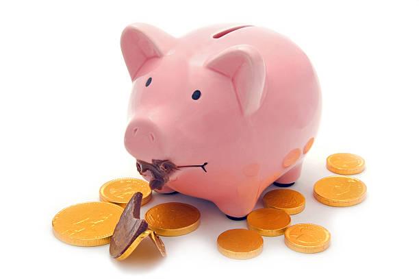 Eating into the savings stock photo