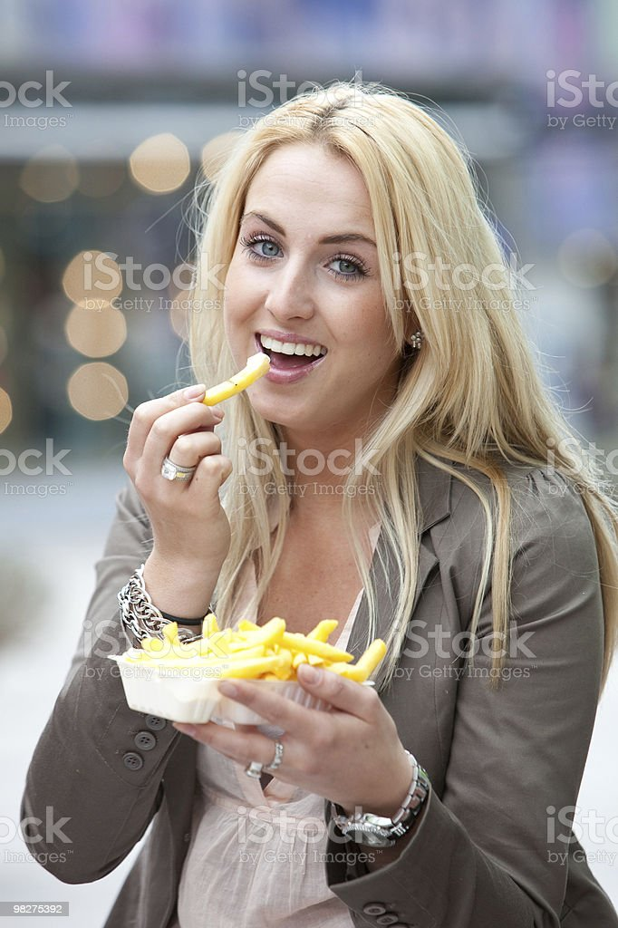 Eating junkfood royalty-free stock photo