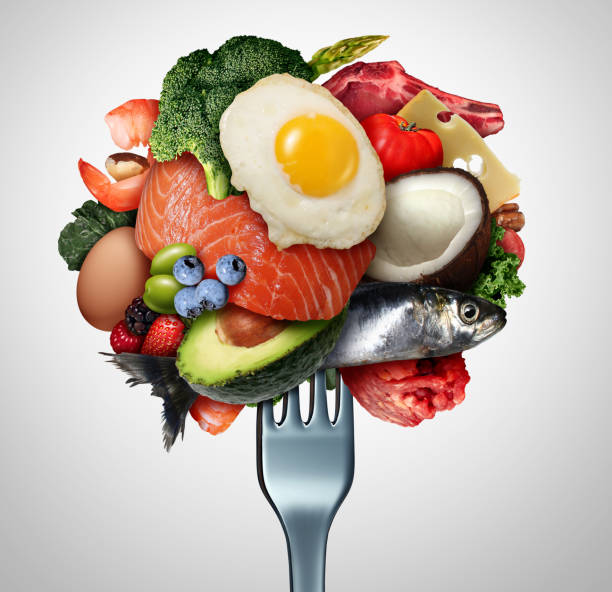 Eating Ketogenic Food Eating ketogenic food and Keto nutrition lifestyle diet low carb and high fat meal as fish nuts eggs meat avocado and other healthy ingredients as a therapeutic snacks on a fork with 3D illustration elements. unhealthy eating stock pictures, royalty-free photos & images