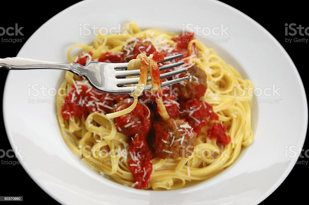 Eating Linguine and Meatballs royalty-free stock photo