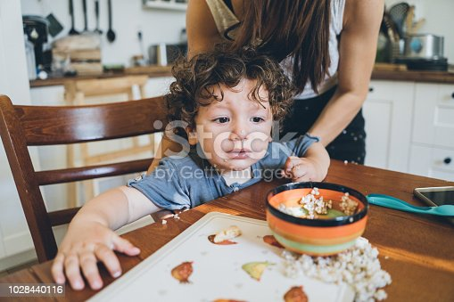 Cute little boy Eating lunch and making mess