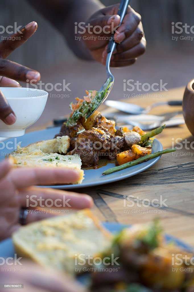 Eating Meaty Stew stock photo