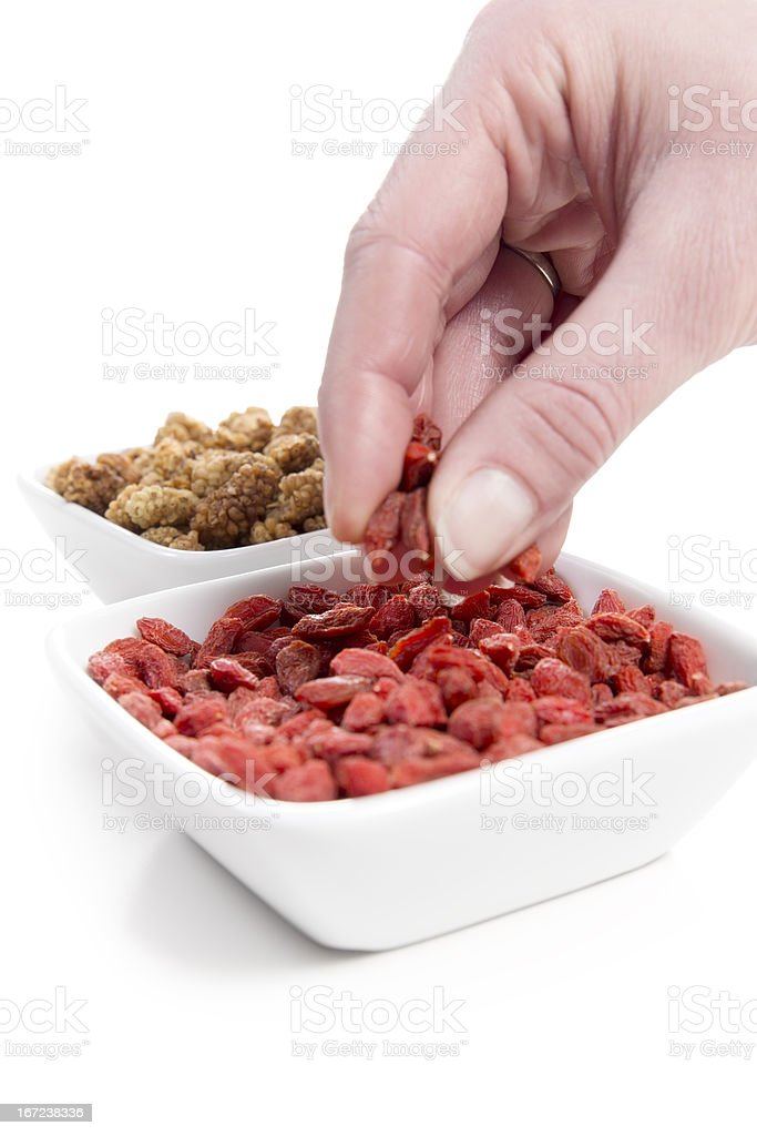 Eating Mulberries and Goji berries royalty-free stock photo