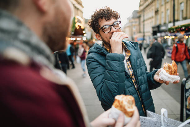 eating on the go - people uk stock photos and pictures