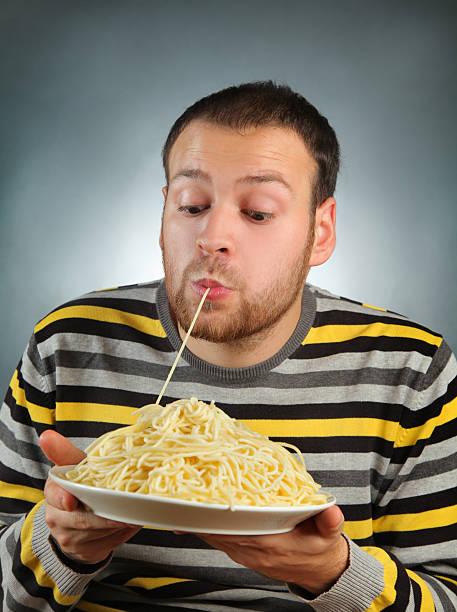 eating pasta stock photo