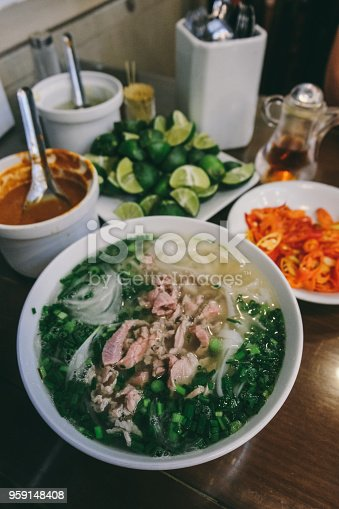 Pho Bo with beef, limes and pepper street food in Hanoi,Vietnam