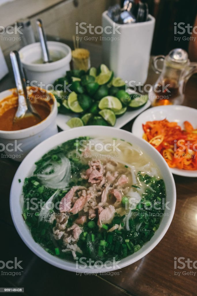 Eating Pho Bo - traditional Vietnamese soup, Hanoi, Vietnam stock photo