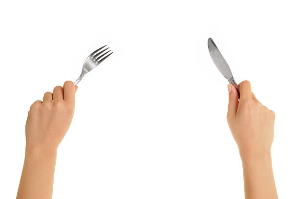 eating isolated on white hands holding knife and fork fork stock pictures, royalty-free photos & images