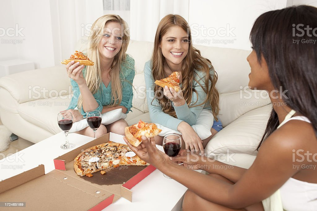 Eating pizza. stock photo