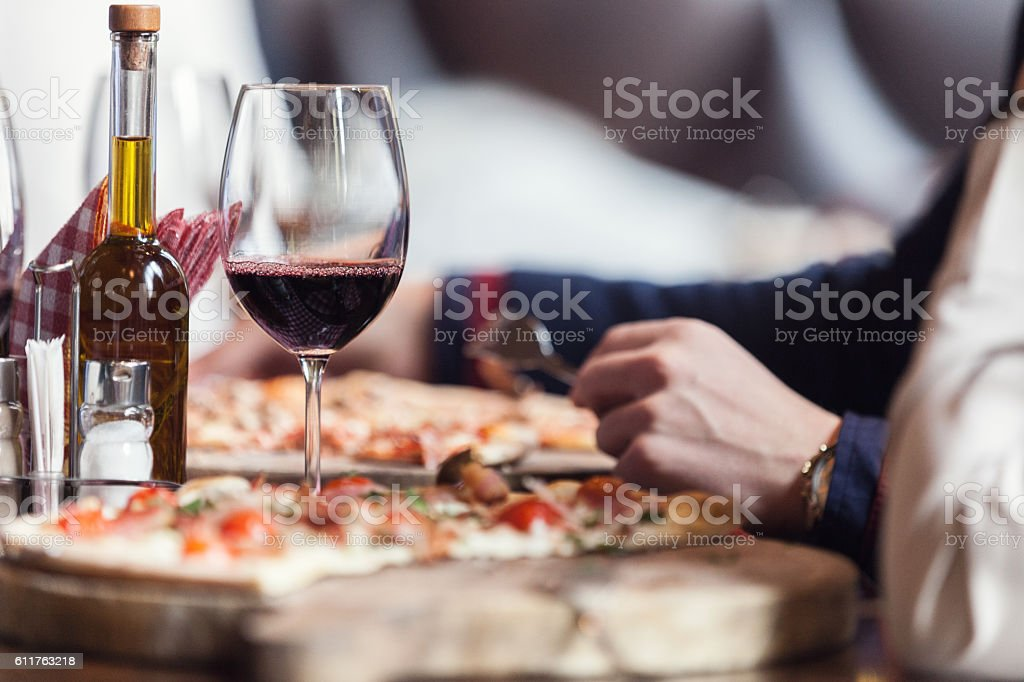 Eating pizza stock photo