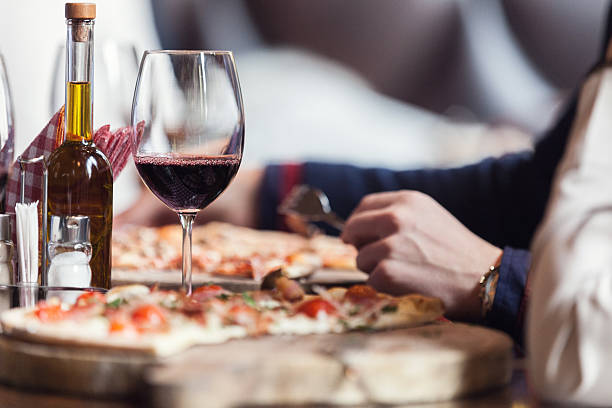 eating pizza - italian food stock photos and pictures